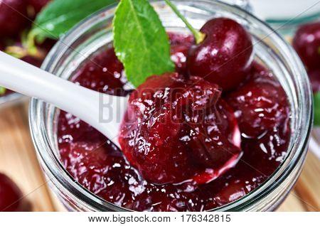 Cherry jam in a jar. Homemade fruit jam
