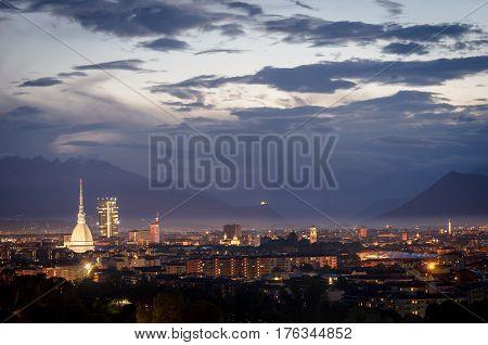 Turin cityscape with Mole Antonelliana and Sacra di San Michele