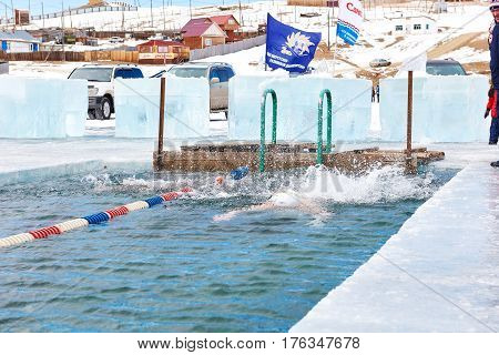 Sahyurta ,irkutsk Region, Russia - March 11.2017: Cup Of Baikal. Winter Swimming. Butterfly