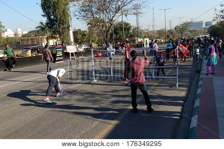 HYDERABAD,INDIA-FEBRUARY 19:People play badminton on Sundays in open road as Physical Literacy Days on February 19,2017 in Hyderabad,India.