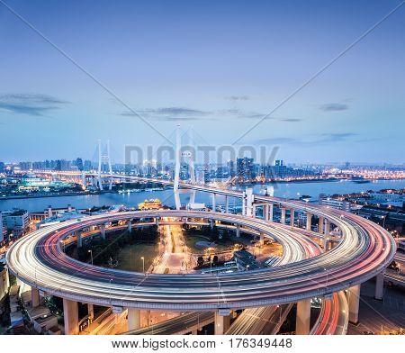 shanghai nanpu bridge in nightfall busy traffic background