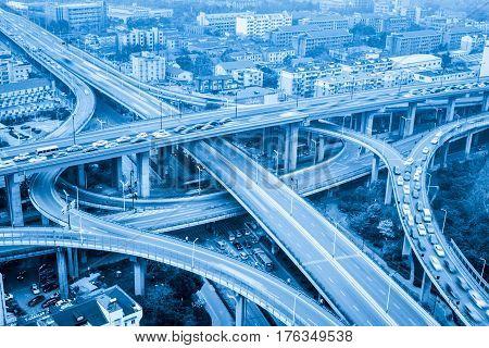 city highway interchange closeup motion blur with blue tone