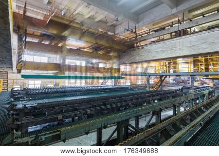 industrial production workshop closeup in a lead and zinc metal factory automatic peeling zinc production line