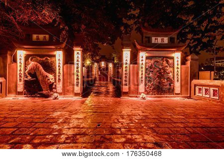HANOI VIETNAM - March 08 2017: Red Bridge- The Huc Bridge in Hoan Kiem Lake Hanoi Vietnam. Night view. This is a lake in the historical center of Hanoi the capital city of Vietnam
