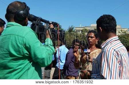 HYDERABAD,FEBRUARY 19:TV reporter with cameraman interview LGBT activist demanding equal rights during Queer Swabhimana Yatra 2017 on February 19,2017 in Hyderabad,India