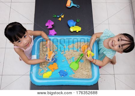 Happy Asian Chinese Little Girls Playing Kinetic Sand At Home