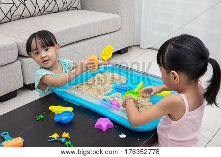 Asian Chinese Little Girls Playing Kinetic Sand At Home