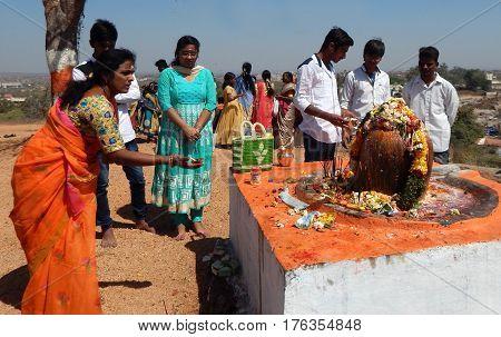 KEESRAGUTTA,HYDERABAD,INDIA-FEBRUARY 24:Hindus perform Puja to lord Shiva stone statue, near the temple, in Mahasihvaratri fesival on February 24,2017 in Hyderabad,