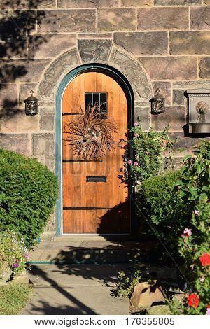 Antique wooden, oak front door, stone and limestone façade, western  Pennsylvania
