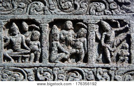 Indian Hindu Architectural details of stone carvings in an ancient temple depicting scenes in epics