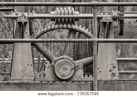 A toned B&W of antique machinery found at the Post Falls Dam park in Post Falls Idaho.