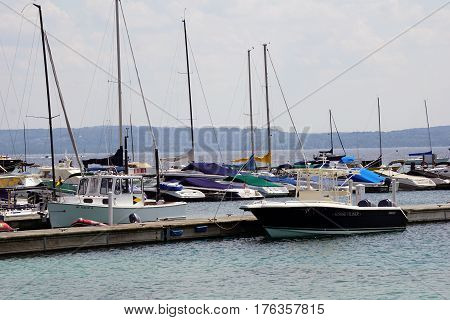 HARBOR SPRINGS, MICHIGAN / UNITED STATES - AUGUST 4, 2016: Boats are moored at the Walstrom Marine docks in Harbor Springs.