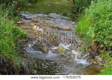 Flowing water in mountain stream. Ukrainian Carpathians