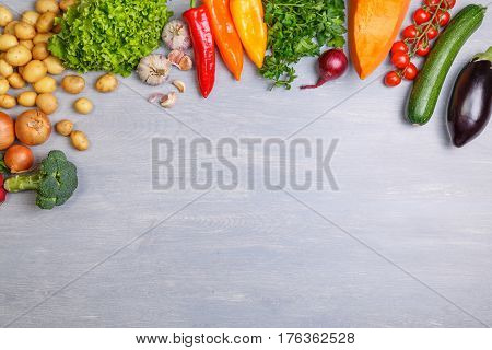 Fresh vegetables. Tomato, zucchini and eggplant. Potatoes, onion and garlic. Pepper, brocoli and salad. Pumpkin and parsley. Organic vegetables with copy space.