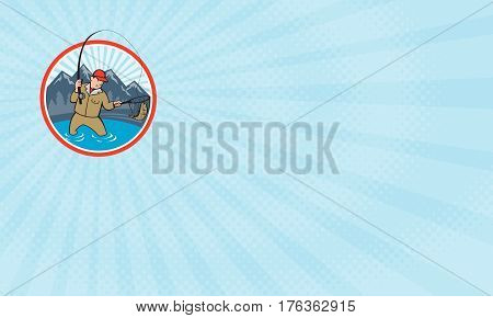 Business card showing Illustration of a fly fisherman with fly rod and reel reeling and netting up a trout fish set inside circle with lake trees and mountain in background done in cartoon style.