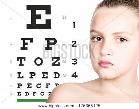 young girl with test vision table over background. concept of preservation children's vision.