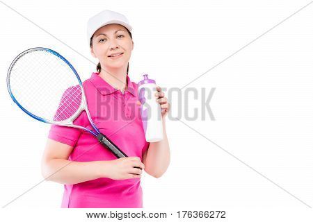 Beautiful Girl With A Racket And A Bottle Of Water After A Game Of Tennis And Space On The Right