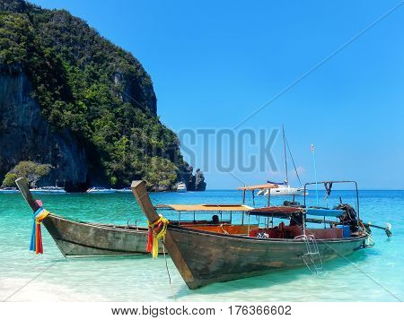 Longtail Boats Anchored At Ao Yongkasem Beach On Phi Phi Don Island, Krabi Province, Thailand