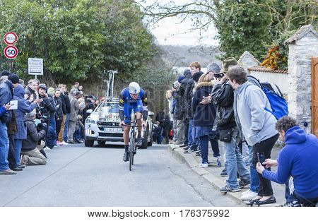 Conflans-Sainte-HonorineFrance-March 62016: The Belgian cyclist Stijn Vandenbergh of Etixx-Quick Step Team riding during the prologue stage of Paris-Nice 2016.