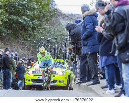 Conflans-Sainte-HonorineFrance-March 62016: The Russian cyclist Yuri Viktorovich Trofimov of Tinkoff Team riding during the prologue stage of Paris-Nice 2016.