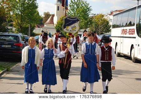Neuoetting,Germany- September 18,2010: Memeber of a bavarian marching band get ready for their turn in a parade