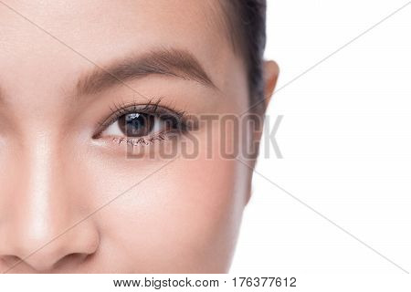 Eyes. Closeup of beautiful asian woman with brown eyes make up eye shadow