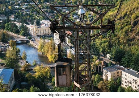 Derelict and rundown aerial old tram ropeway or cable car leading to the abandoned area in Chiatura. Industrial landmark of Georgia.