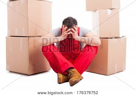 Mover Man Sitting Down With Hands On His Head