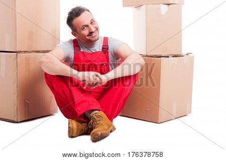 Mover Man Sitting On The Floor Surrounded By Boxes
