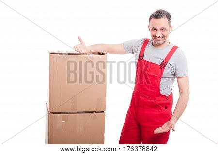 Mover Man Smiling And Showing Cardboard Boxes