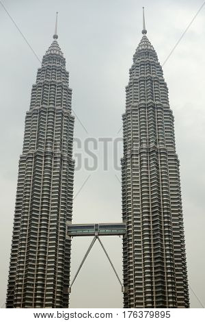 Kuala Lumpur Malaysia - November 5 2014: 88-storey Petronas Twin Towers - the main attraction of Kuala Lumpur. This is the highest twin towers in the world.