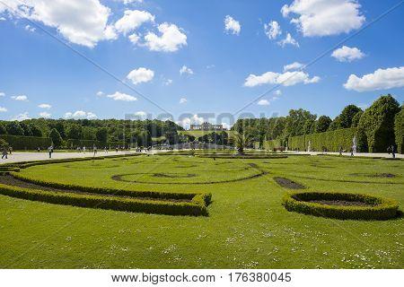 VIENNA AUSTRIA - MAY 8 2016: Tourist walks at garden in Gloriette Schonbrunn palace Vienna Austria May 8 2016