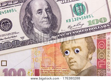 100 dollar bill and 100 hryvnia with big eyes of the president. Surprised dollar concept.