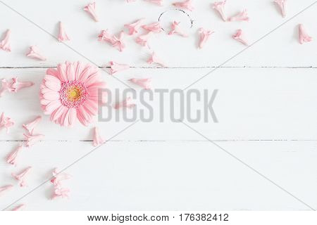 Flowers composition. Pink flowers on white wooden background. Flat lay top view