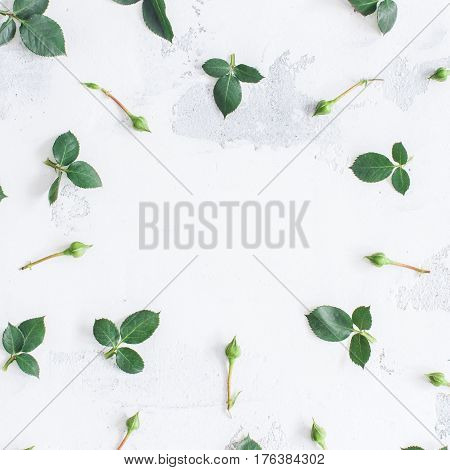 Flowers composition. Frame made of green leaf and rose flowers. Flat lay top view