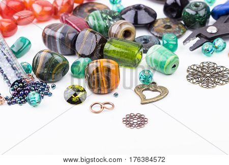 Semi-precious stone beads crystals glass beads metal components and seedbeads for making jewelry. Selective focus.