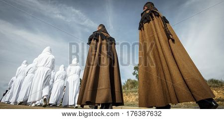 Wide angle of easter traditional procession people in bercianos de aliste brotherhood, zamora, Spain. Rear view