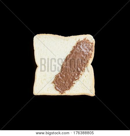 Closeup slice bread with chocolate for breakfast with shadow isolated on black background