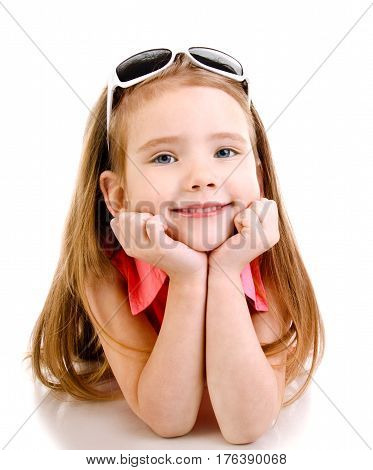 Portrait of cute smiling little girl lying on the floor isolated on a white