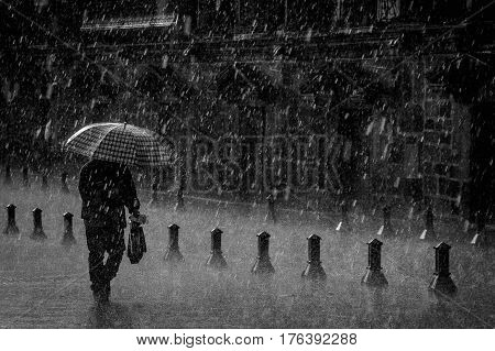 Man walking under the rain in quito