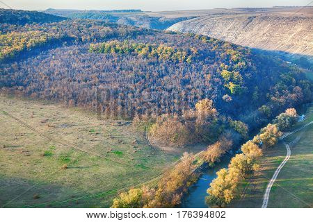 aerial view of idyllic landscape with river and hills