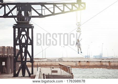 brave man falling from the crane into water