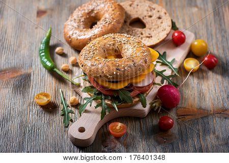 Vegetarian bagel sandwich with fresh veggies and arugula salad vegan healthy food lunch breakfast snack