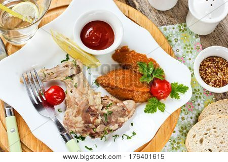 Rabbit leg boiled with herbs vegetable puree and tomato sauce dietetic food concept