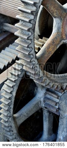 Close up of iron gears of an old machine