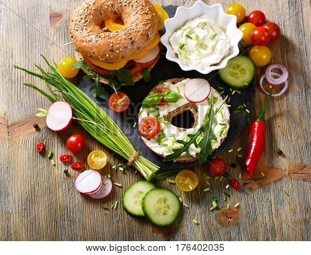 Vegetarian bagel sandwich with fresh veggies and arugula salad vegan healthy food lunch breakfast picknick snack