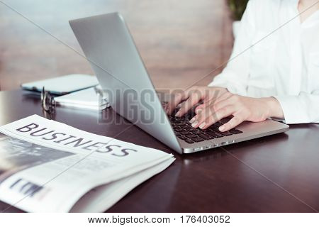 Close-up Partial View Of Woman Working With Laptop