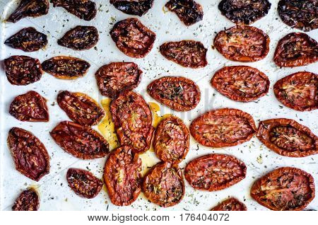 Sun dried tomatoes on a metal tray, top view