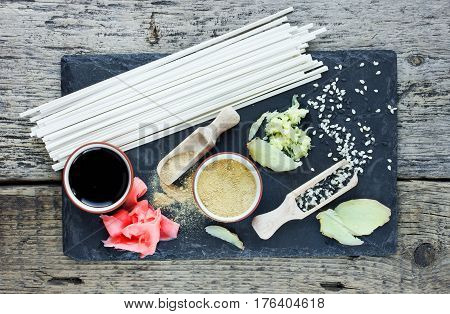 Traditional japanese food ingredients: udon noodles ginger sesame seeds soy sauce top view