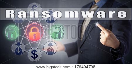 Cyber security consultant in blue shirt and suit explaining Ransomware. Information technology metaphor and computer security concept for extortion of ransom money for removal of access restriction.